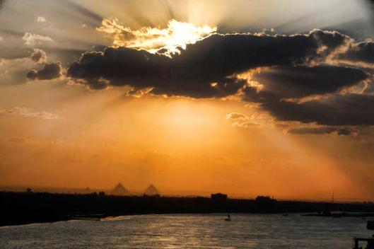 Good Evening Cairo! THIS BEAUTIFUL VIEW everyday here in magical Cairo. Enjoy! You can see Pyramids in the background.