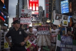 """Syria, same as Iraq"", ""U.S., NATO, Hands Off Syria"" say the HUNDREDS who turned out to protest at NYC's Times Square last Thursday."