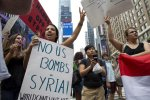 Opponents of a United States military strike against Syria protest at Times Square in New York City, Saturday, August 31.