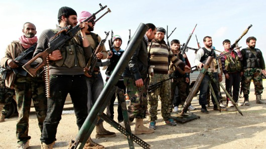 U.S., U.K. and Australian trained rebels await their new American weapons.
