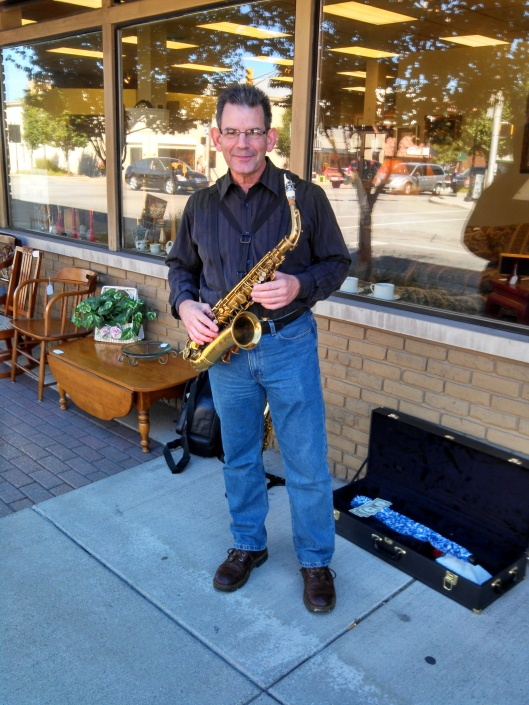 "Joe Knapp, from Goshen, IN on a downtown Nappanee sidewalk is about to play ""Stairway to Heaven"" at my husband's request. There is so much going on in Nappanee today!"